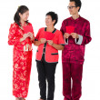 Chinese family with ang pow - Stock Photo