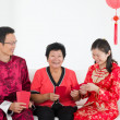 Chinese new year celebration by asian family — Stock Photo