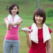 Chinese girls working out at park — Stock Photo #19206475