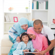 Indonesian malay family having a good time surfing internet — Stock Photo #19647475