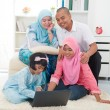 Stock Photo: Indonesimalay family having good time surfing internet