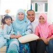 Stock Photo: Indonesimalay family having good time