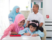 Indonesian malay family doing homework together, quality time — Stock Photo