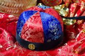 Chinese new year hat with decorations on the background — Stock Photo