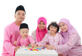 Malay family during hari raya — Stock Photo