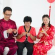 Chinese family celebrating lunar new year — Stock fotografie
