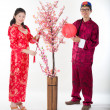 Chinese new year husband and wife couple — Stock Photo