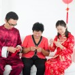 Chinese family celebrating lunar new year — Stok fotoğraf