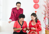 Chinese family celebrating lunar new year — Stock Photo