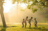 Chinese family having quality time playing at outdoor park — Stok fotoğraf