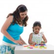Happy looking indian mother and daughter learning with education — Stock Photo