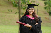 South asian female graduate with green background — Stock Photo
