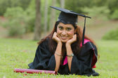 Indian female graduate with green background — Stock Photo