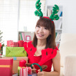Asian girl christmas celebration at her home — Stock Photo