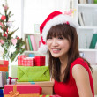 Asian girl christmas celebration at her home — Stock Photo #22668397