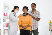 Indian senior citizen health check with a chinese female doctor — Stock Photo