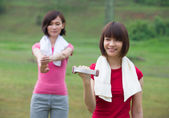 Chinese sisters workout outdoor inside a green park — Stock Photo