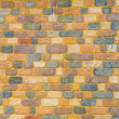 Stock Photo: Yellow brick wall for background texture purpose