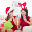 Japanese girl friends during a christmas celebration — Stock Photo