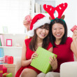 Stock Photo: Korean girl friends during christmas celebration