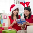 Korean girl friends during christmas celebration — Stock Photo #23379078
