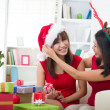 Korean girl friends during christmas celebration — Stockfoto