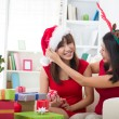 Korean girl friends during christmas celebration — Stock fotografie