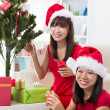 Chinese christmas celebration among friends with home background — Stock Photo