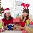 Asian girls during christmas celebration with home background — Stock Photo