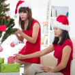图库照片: Asian girls during christmas celebration with home background