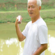Stok fotoğraf: Chinese Asian senior man healthy lifestyle working out on a park