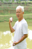 Chinese Asian senior man healthy lifestyle working out on a park — Stock Photo