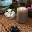 Stock Photo: Hot stone massage with sptreatment items on background