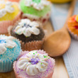 Beautiful cup cakes muffins with baking background — Stock Photo #23988975