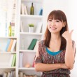 Chinese female in living room lifestyle photo — Stock Photo