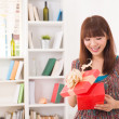 Beautiful chinese woman happy receiving gift with lifestyle back — Stock Photo