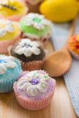 Beautiful cup cakes muffins with baking background — Stock Photo