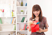 Beautiful chinese woman happy receiving gift with lifestyle back — Stockfoto