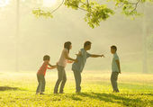 Happy asian family playing having quality time at outdoor green — Stock Photo