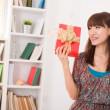 Japanese woman happy receiving gift with lifestyle background — Stock Photo