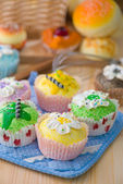 Cup cakes with a lot of bread pastry background — Stock Photo