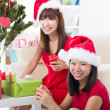 Chinese girl friends during a christmas celebration — Stock Photo #24770177