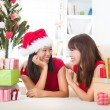 Chinese girl friends during a christmas celebration — Stock Photo #24770231