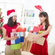 Chinese girl friends during a christmas celebration — Stock Photo #24770297