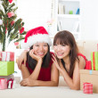 Chinese girl friends during a christmas celebration — Stock fotografie