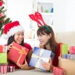 Chinese girl friends during a christmas celebration — Stock Photo #24770311