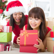 Chinese girl friends during a christmas celebration — Foto de Stock