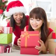 Chinese girl friends during a christmas celebration — Stock Photo #24770313