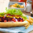 Hot dog and bacon served with mustard tomatoes and plenty of bac - Stok fotoğraf