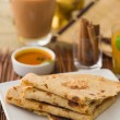 Постер, плакат: Chapati Indian flat bread in plate usually served with curry